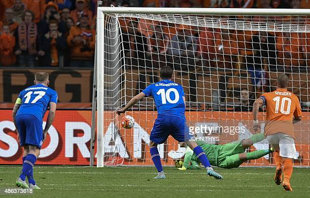 Iceland's midfielder Gylfi Thor Sigurdsson scores a penalty kick during the UEFA Euro 2016 qualifying round football match between Netherlands and...