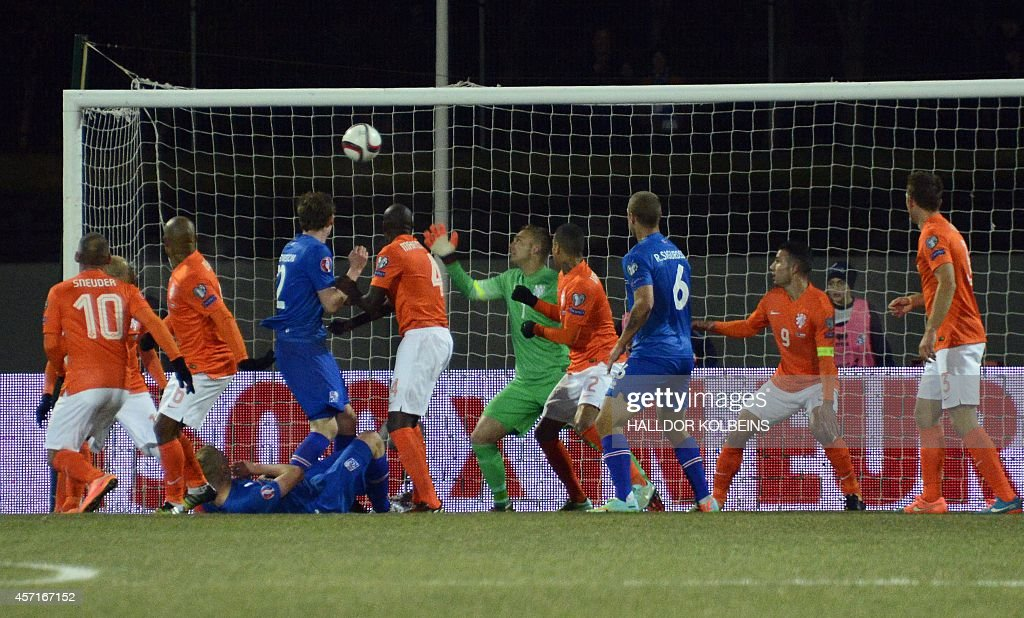 Iceland's midfielder Gylfi Thor Sigurdsson scores duirng the Euro 2016 Group A qualifying football match Iceland vs the Netherlands in Reykjavik...