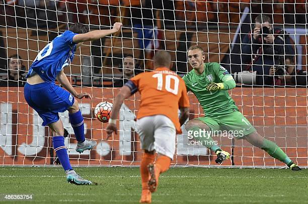 Iceland's midfielder Gylfi Thor Sigurdsson shoots a penalty and scores during the UEFA Euro 2016 qualifying round football match between Netherlands...