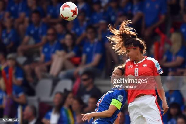 Iceland's midfielder Sara Bjork Gunnarsdottir vies with Switzerland's forward Cinzia Zehnder during the UEFA Womens Euro 2017 football tournament...