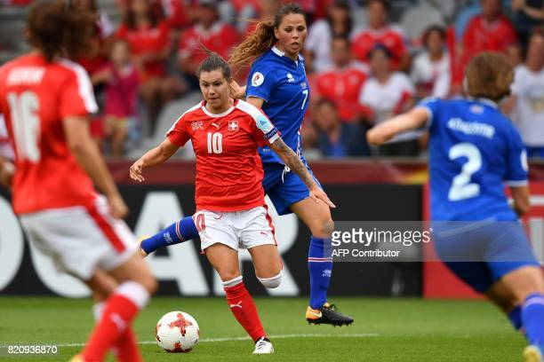 Iceland's midfielder Sara Bjork Gunnarsdottir vies with Switzerland's forward Ramona Bachmann during the UEFA Womens Euro 2017 football tournament...