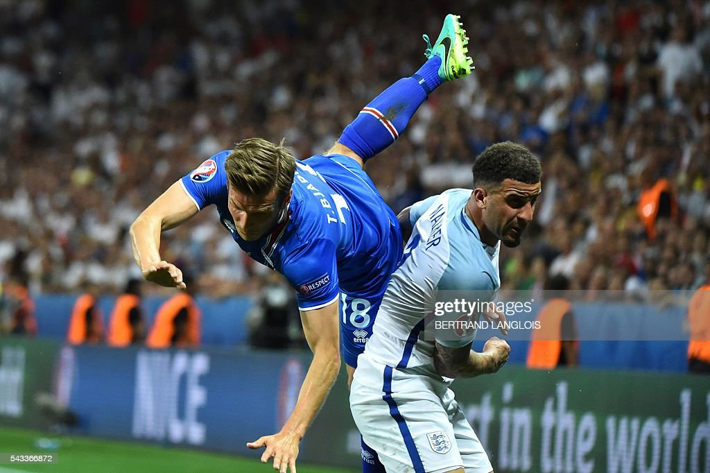 Iceland's midfielder Theodor Bjarnason and England's defender Kyle Walker (R) vie for the ball during the Euro 2016 round of 16 football match between England and Iceland at the Allianz Riviera stadium in Nice on June 27, 2016. / AFP / BERTRAND