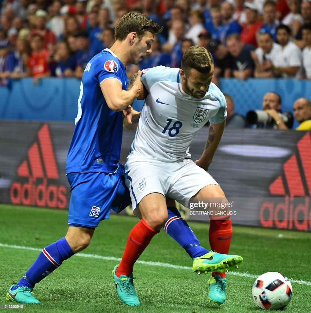Iceland's midfielder Theodor Bjarnason and England's midfielder Jack Wilshere vie for the ball during the Euro 2016 round of 16 football match between England and Iceland at the Allianz Riviera stadium in Nice on June 27, 2016. / AFP / BERTRAND