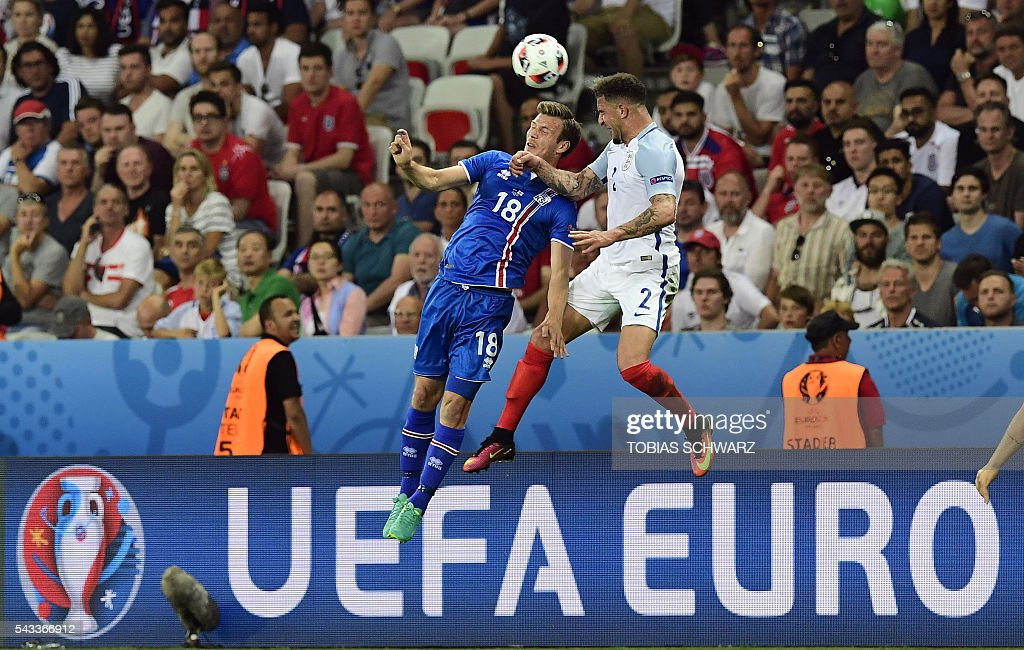 Iceland's midfielder Theodor Bjarnason (L) vies for the ball against England's defender Kyle Walker during Euro 2016 round of 16 football match between England and Iceland at the Allianz Riviera stadium in Nice on June 27, 2016. / AFP / TOBIAS