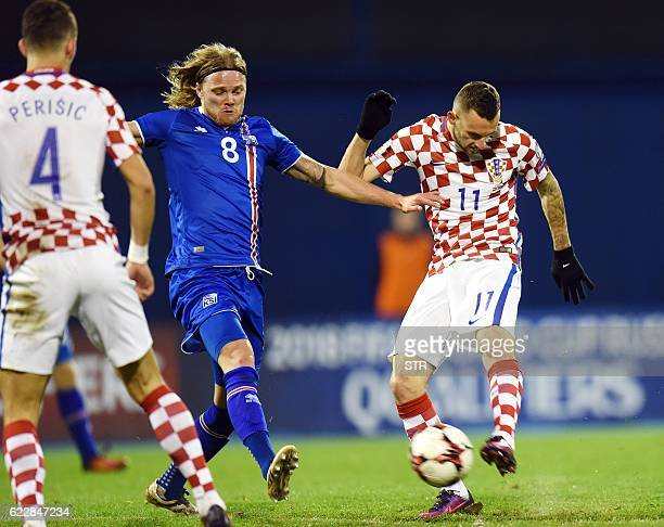Iceland's midfiielder Birkir Bjonarsson vies with Croatia's midfielder Marcelo Brozovic during the 2018 World Cup football qualification match...