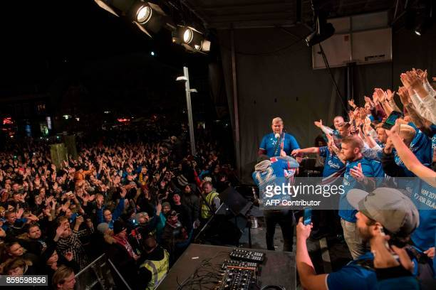 Iceland's national team football players and coaching staff celebrate with fans at Ingolfstorg square in the centre of Reykjavik after the FIFA World...