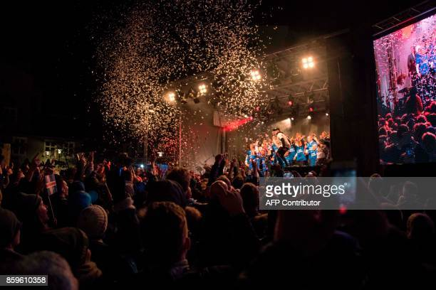 TOPSHOT Iceland's national team football players and coaching staff celebrate with fans at Ingolfstorg square in the centre of Reykjavik after the...
