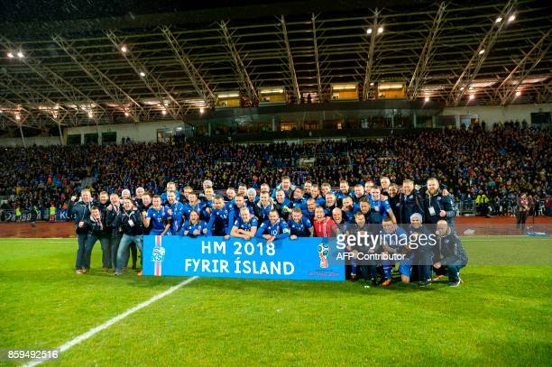 Iceland's players and coaching staff celebrate after the FIFA World Cup 2018 qualification football match between Iceland and Kosovo in Reykjavik...