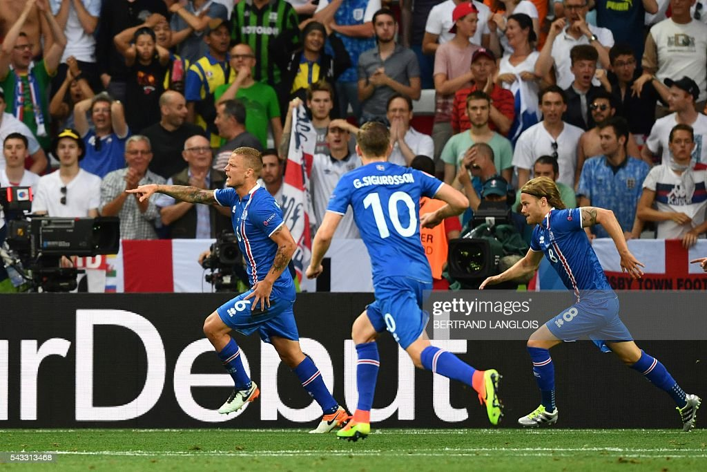 Iceland's players celebrate after Iceland's defender Ragnar Sigurdsson (L) scored a goal during the Euro 2016 round of 16 football match between England and Iceland at the Allianz Riviera stadium in Nice on June 27, 2016. / AFP / BERTRAND
