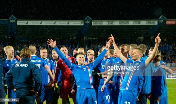Iceland's players celebrate after the FIFA World Cup 2018 qualification football match between Iceland and Kosovo in Reykjavik Iceland on October 9...