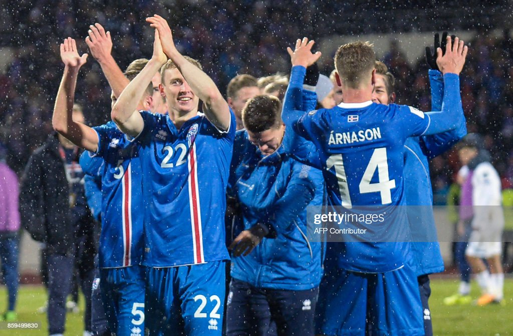 Iceland's players celebrate after the FIFA World Cup 2018 qualification football match between Iceland and Kosovo in Reykjavik, Iceland on October 9, 2017. Iceland qualified for the FIFA World Cup 2018 as smallest country ever after beating Kosovo 2-0 at home in Reykjavik. / AFP PHOTO / Haraldur Gudjonsson / ALTERNATIVE