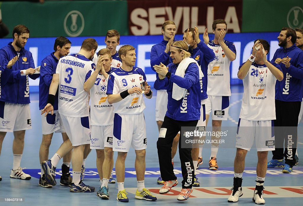 Iceland's players celebrate after winning the 23rd Men's Handball World Championships preliminary round Group B match Chile vs Iceland at the Palacio de Deportes San Pablo in Sevilla on January 13, 2013. Iceland won 38-22.