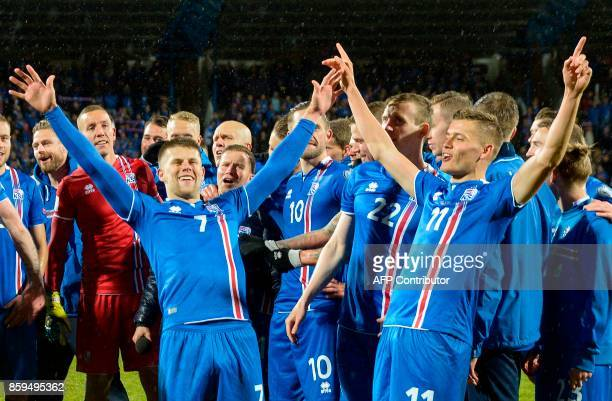 TOPSHOT Iceland's players including Iceland's forward Johann Berg Gudmundsson and Iceland's forward Alfred Finnbogason celebrate after the FIFA World...