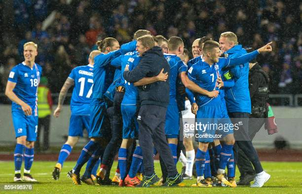 Iceland's players including Iceland's forward Johann Berg Gudmundsson celebrate after the FIFA World Cup 2018 qualification football match between...