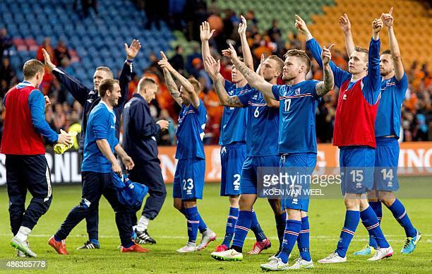Iceland's players jubilate at the end of the UEFA Euro 2016 qualifying round football match between Netherlands and Iceland on September 3 2015 at...