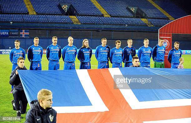 Iceland's players look on during the national anthem prior to the 2018 World Cup football qualification match between Croatia and Iceland at the...