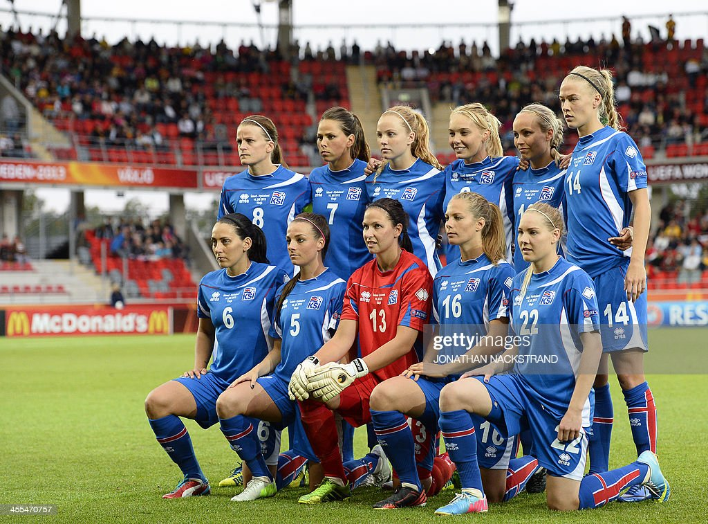 Iceland's players pose for their team's photo prior to the UEFA Women's European Championship Euro 2013 group B football match Iceland vs Germany on July 14, 2013 in Vaxjo, Sweden. Germany won 3-0.