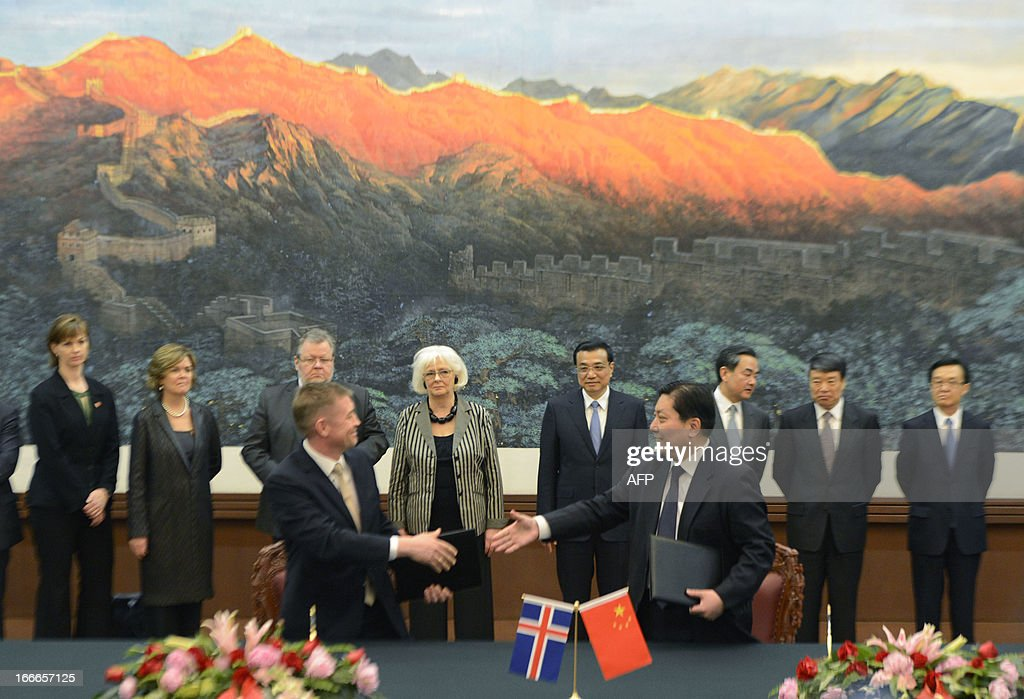 Iceland's prime minister Johanna Sigurdardottir (back centre L) and Chinese Premier Li Keqiang (back centre R) look on during a signing ceremony at the Great Hall of the People in Beijing on April 15, 2013. Sigurdardottir will also meet with former premier Wen Jiabao and President Xi Jinping, on a visit that will include the signing of a trade deal between Reykjavik and Beijing after six years of negotiations.