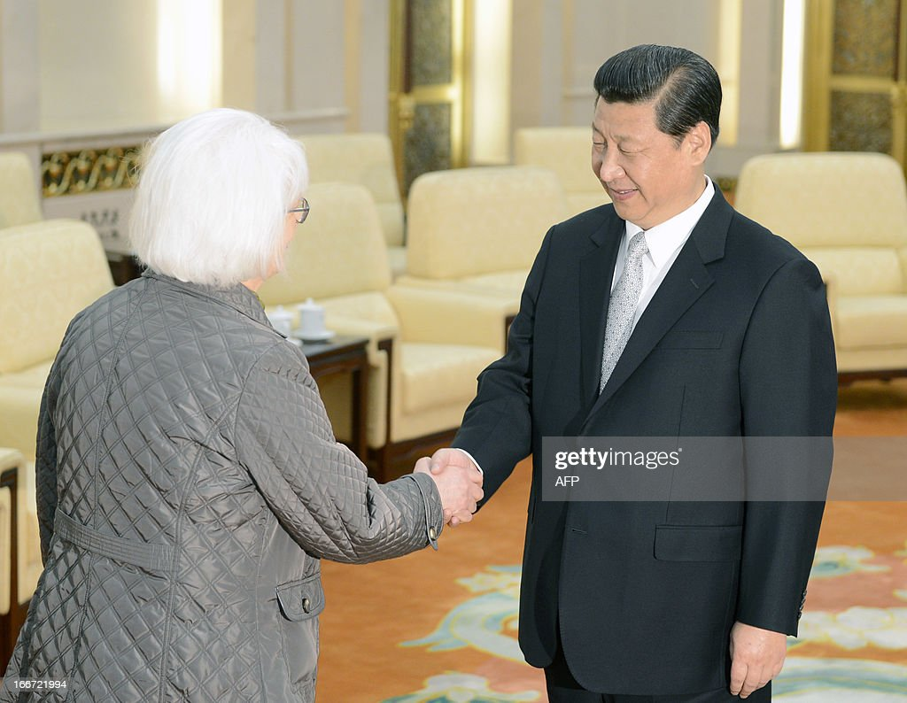 Iceland's prime minister Johanna Sigurdardottir (L) shakes hands with Chinese President Xi Jinping during a meeting at the Great Hall of the People in Beijing April 16, 2013. Iceland on April 15 became the first European country to sign a free trade agreement with China, as Beijing looks to gain a foothold in the strategic Arctic region. AFP PHOTO / POOL / YOHSUKE MIZUNO