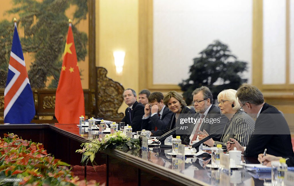 Iceland's prime minister Johanna Sigurdardottir (C) talks with Chinese Premier Li Keqiang (not pictured) during a meeting at the Great Hall of the People in Beijing on April 15, 2013. Sigurdardottir will also meet with former premier Wen Jiabao and President Xi Jinping, on a visit that will include the signing of a trade deal between Reykjavik and Beijing after six years of negotiations.