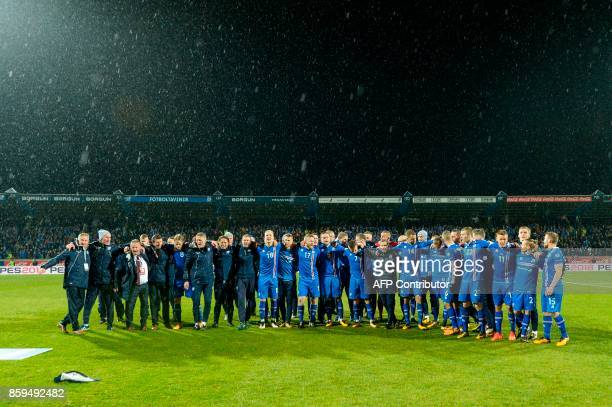 Iceland's team celebrate after the FIFA World Cup 2018 qualification football match between Iceland and Kosovo in Reykjavik Iceland on October 9 2017...