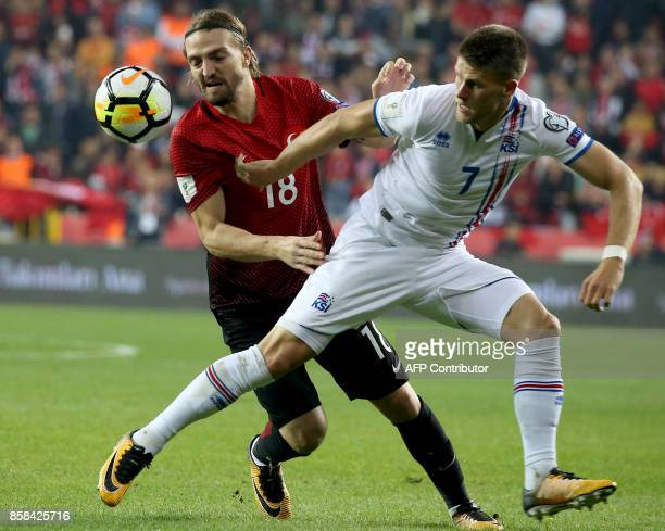 Icelans's Johann Gudmundsson vies for the ball with Turkey's defender Caner Erkin during the FIFA World Cup 2018 qualification football match between...