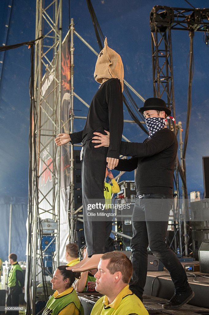 Iceman Thesis, a secretive group with unknown indentities, performs a one off show on stage at Download Festival at Donnington Park on June 14, 2014 in Donnington, United Kingdom.