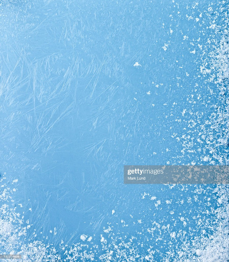 Icey frost on blue background. : Stock Photo