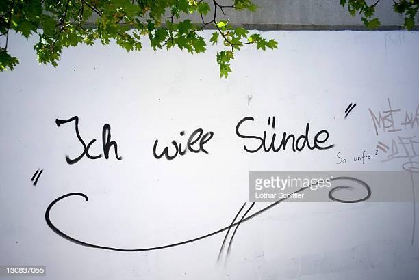 Ich will Suende (I want sin), graffiti on a white wall