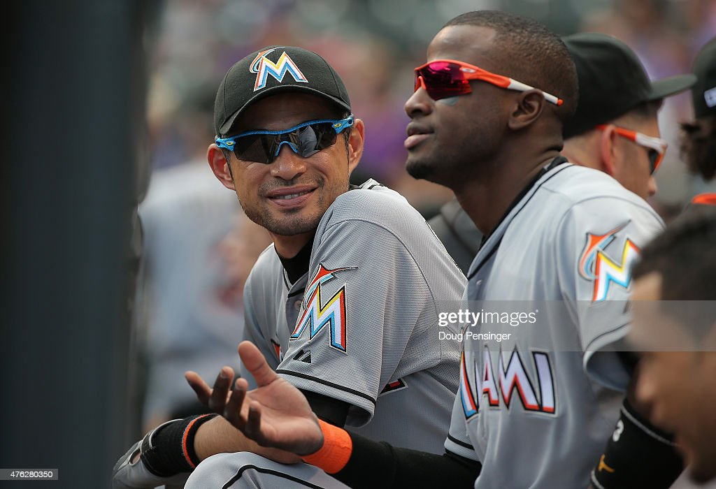 <a gi-track='captionPersonalityLinkClicked' href=/galleries/search?phrase=Ichiro+Suzuki&family=editorial&specificpeople=201556 ng-click='$event.stopPropagation()'>Ichiro Suzuki</a> #51 and <a gi-track='captionPersonalityLinkClicked' href=/galleries/search?phrase=Adeiny+Hechavarria&family=editorial&specificpeople=6926508 ng-click='$event.stopPropagation()'>Adeiny Hechavarria</a> #3 of the Miami Marlins look on from the dugout against the Colorado Rockies at Coors Field on June 7, 2015 in Denver, Colorado.