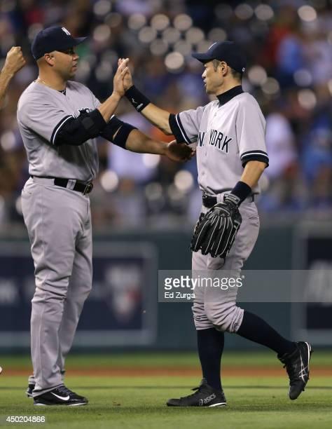 Ichiro Suzuki and Carlos Beltran of the New York Yankees celebrate a 42 win over the Kansas City Royals at Kauffman Stadium on June 6 2014 in Kansas...