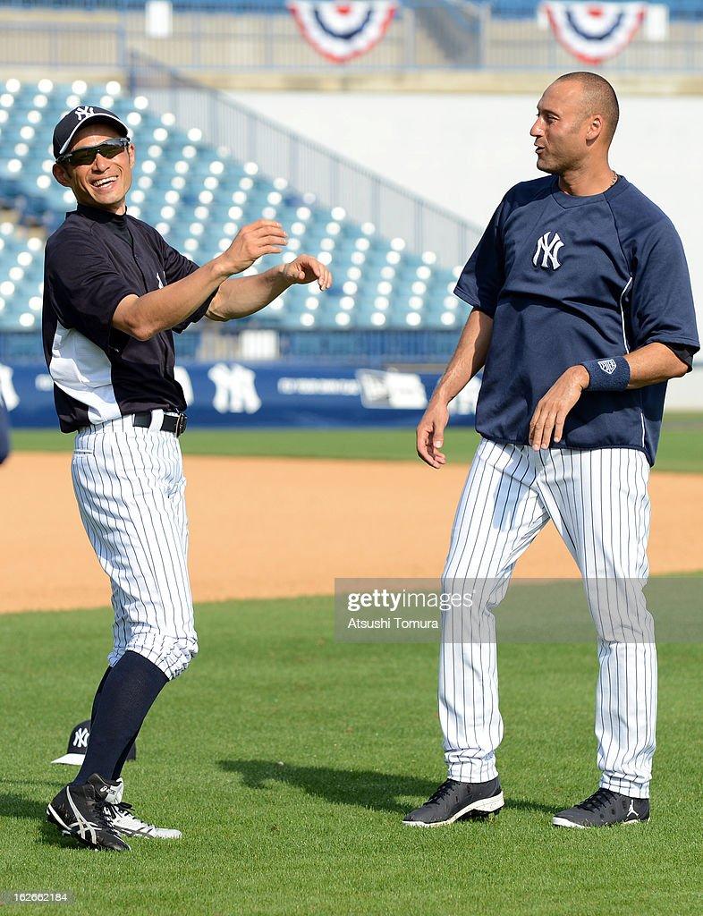 Ichiro Suzuki #31 and Derek Jeter #2 of New York Yankees talk during the New York Yankees spring training on February 25, 2013 in Tampa, Florida.