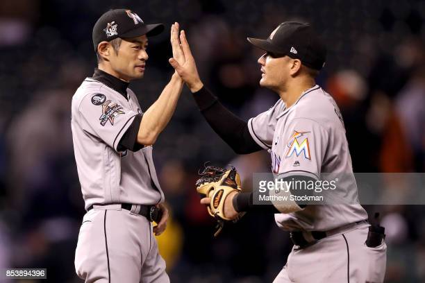Ichiro Suzuki and Miguel Rojas of the Miami Marlins celebrate the Marlins win over the Colorado Rockies at Coors Field on September 25 2017 in Denver...