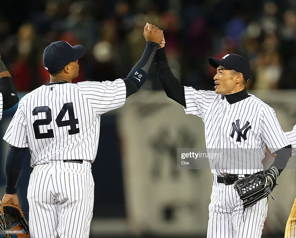 Ichiro Suzuki #31 and Robinson Cano #24 of the New York Yankees celebrate the win over the Boston Red Sox on April 4, 2013 at Yankee Stadium in the Bronx borough of New York City.The New York Yankees defeated the Boston Red Sox 4-2.