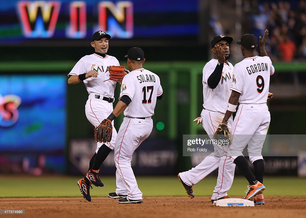 <a gi-track='captionPersonalityLinkClicked' href=/galleries/search?phrase=Ichiro+Suzuki&family=editorial&specificpeople=201556 ng-click='$event.stopPropagation()'>Ichiro Suzuki</a> #51, Donovan Solano #17, <a gi-track='captionPersonalityLinkClicked' href=/galleries/search?phrase=Marcell+Ozuna&family=editorial&specificpeople=10358366 ng-click='$event.stopPropagation()'>Marcell Ozuna</a> #13 and <a gi-track='captionPersonalityLinkClicked' href=/galleries/search?phrase=Dee+Gordon&family=editorial&specificpeople=7091343 ng-click='$event.stopPropagation()'>Dee Gordon</a> #9 of the Miami Marlins celebrate after the game against the New York Yankees at Marlins Park on June 16, 2015 in Miami, Florida.