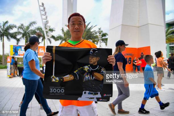 Ichiro Suzuki fans enter the stadium before the game in which Ichiro Suzuki of the Miami Marlins will be honored for his 3000th Hit before the game...