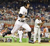 Ichiro Suzuki grounds out as a pinch hitter during the eighth inning of the Miami Marlins' 40 loss to the Philadelphia Phillies at Marlins Park in...