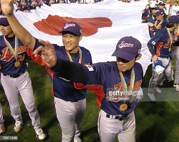 Ichiro Suzuki leads team Japan as they take a victory lap around the field after it's victory over Cuba in the Championship Game of the of the 2006...