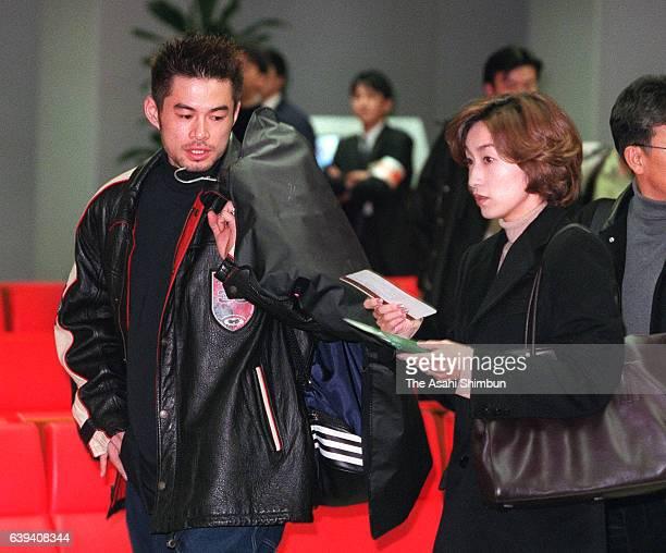 Ichiro Suzuki of Orix Bluewave and his wife Yumiko are seen on departure at the Kansai International Airport on November 28 2000 in Izumisano Osaka...