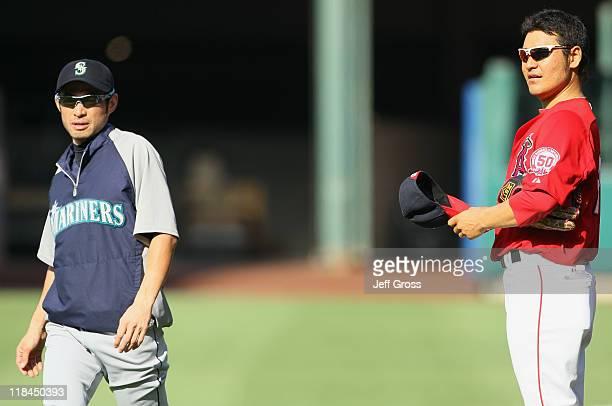 Ichiro Suzuki of Seattle Mariners and Hisanori Takahashi of the Los Angeles Angels of Anaheim talk prior to the start of the game at Angel Stadium of...
