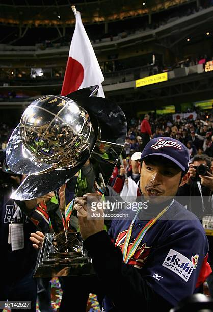 Ichiro Suzuki of Team Japan celebrates with the World Baseball Classic Trophy after defeating Team Cuba in the Final game of the World Baseball...