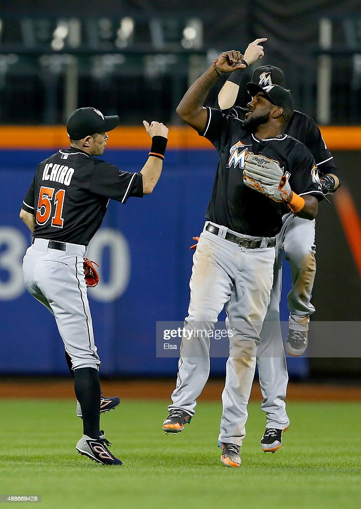 <a gi-track='captionPersonalityLinkClicked' href=/galleries/search?phrase=Ichiro+Suzuki&family=editorial&specificpeople=201556 ng-click='$event.stopPropagation()'>Ichiro Suzuki</a> #51 of the Miami Marlins and teammates <a gi-track='captionPersonalityLinkClicked' href=/galleries/search?phrase=Christian+Yelich&family=editorial&specificpeople=9527291 ng-click='$event.stopPropagation()'>Christian Yelich</a> #21 and <a gi-track='captionPersonalityLinkClicked' href=/galleries/search?phrase=Marcell+Ozuna&family=editorial&specificpeople=10358366 ng-click='$event.stopPropagation()'>Marcell Ozuna</a> #13 celebrate the win over the New York Mets on September 16, 2015 at Citi Field in the Flushing neighborhood of the Queens borough of New York City.