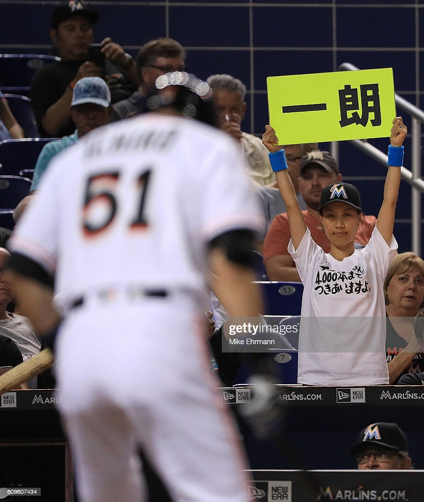 Ichiro Suzuki #51 of the Miami Marlins at bat as a fan holds up a sign during a game against the Washington Nationals at Marlins Park on September 21, 2016 in Miami, Florida.