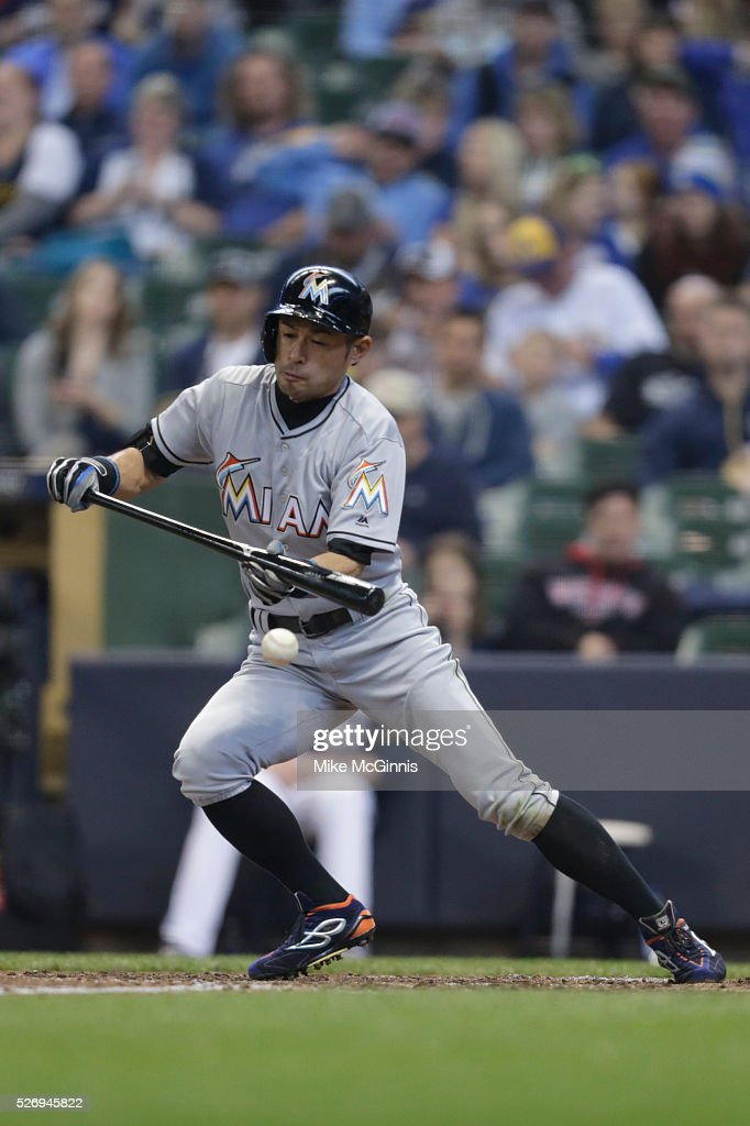 Ichiro Suzuki #51 of the Miami Marlins attempts to lay down a bunt during the sixth inning against the Milwaukee Brewers at Miller Park on May 01, 2016 in Milwaukee, Wisconsin.