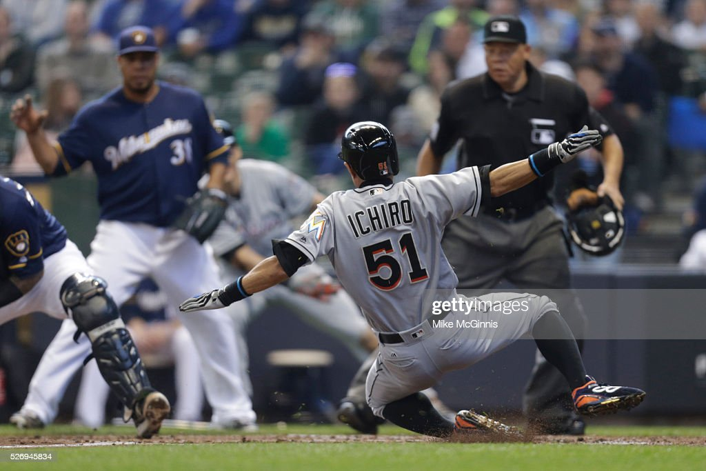 Ichiro Suzuki #51 of the Miami Marlins beats the tag from Martin Maldonado #12 of the Milwaukee Brewers for a double in the third inning at Miller Park on May 01, 2016 in Milwaukee, Wisconsin.