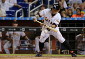 Ichiro Suzuki of the Miami Marlins bunts in the eighth inning during a game against the San Francisco Giants at Marlins Park on June 30 2015 in Miami...