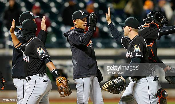 Ichiro Suzuki of the Miami Marlins celebrates with teammate Justin Bour after defeating the New York Mets at Citi Field on April 12 2016 in the...