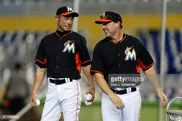 Ichiro Suzuki of the Miami Marlins chats with Manager Mike Redmond during batting practice prior to the start of the game against the Washington...