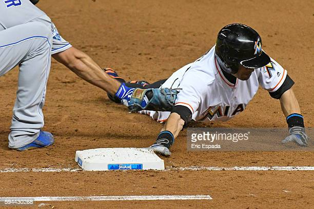 Ichiro Suzuki of the Miami Marlins dives back towards 1st base on a pickoff attempt in the 4th inning against the Kansas City Royals at Marlins Park...