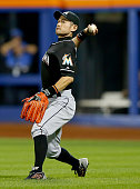 Ichiro Suzuki of the Miami Marlins fields a hit by Michael Conforto of the New York Mets in the eighth inning on September 15 2015 at Citi Field in...